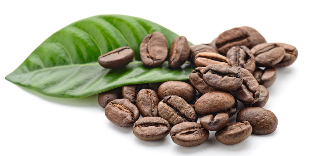Coffee beans with a leaf